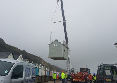 Phase 1, Day 1 - beach lodges are lifted in to place by crane